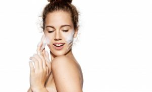 woman applying facial products