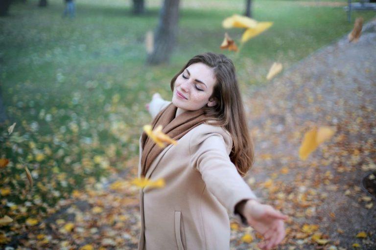 woman happy dancing outside